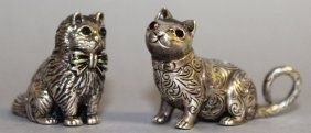 A Pair Of Sterling Silver Miniature Cats.