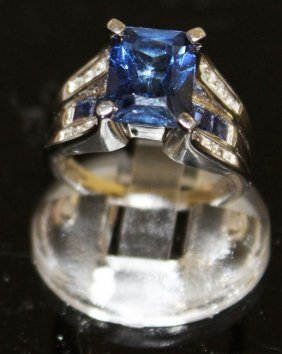 A Square Sapphire Ring With Sapphire And Diamond