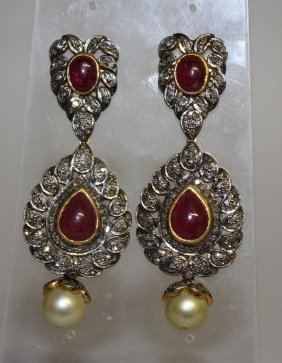A Large Pair Of Diamond Set And Cabochon Ruby Drop