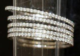 A Silver Four Band Expandable Gem Set Bracelet.