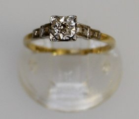 An 18ct Gold Solitaire Diamond Ring.