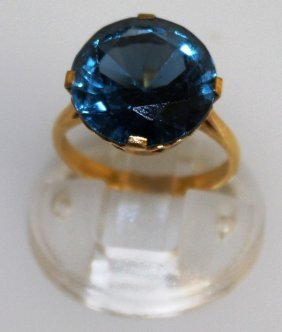 A Large Blue Stone Ring Set In Gold.