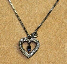 A Diamond Heart Shaped Pendant On Chain.