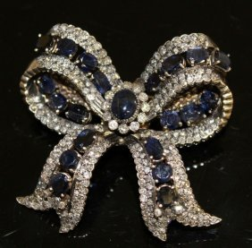 A Superb Diamond, Sapphire And Cabochon Sapphire Bow