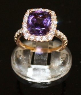 A Good Amethyst And Diamond Cluster Ring Set In 18ct