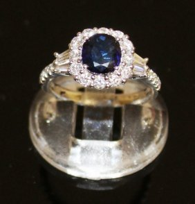 A Sapphire And Diamond Cluster Ring Set In 18ct White