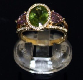 A Peridot, Amethyst And Diamond Ring Set In 18ct White