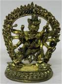 A SMALL GOOD QUALITY SINO-TIBETAN GILT BRONZE GROUP OF