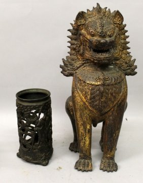 A Thai Gilt Bronze Model Of A Temple Guardian Lion,