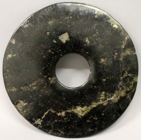 A Large Chinese Neolithic Period Jade Bi Disc, The