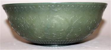 A CHINESE SPINACH GREEN JADELIKE BOWL the sides