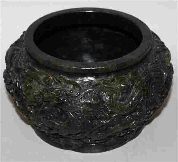 A LARGE CHINESE SPINACH GREEN JADE-LIKE BOWL, the sides
