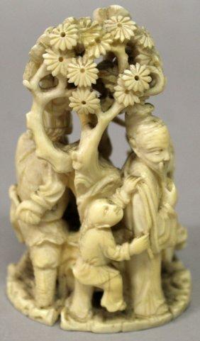 A Japanese Meiji Period Ivory Okimono Of A Group Of