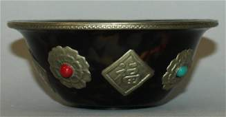 A CHINESE FAUX TORTOISESHELL BOWL, the sides onlaid