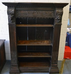 2. A Jacobean Revival Oak Bookcase, With An