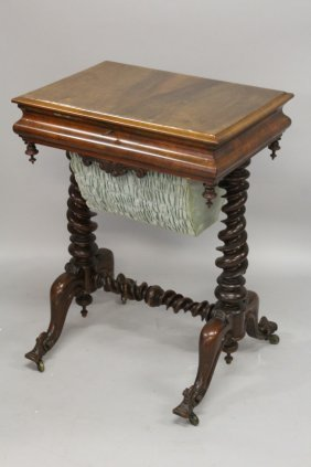 44. A Victorian Walnut Work Table, With A Lifting Top