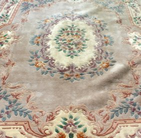 71. A 20th Century Chinese Carpet, Beige Ground With