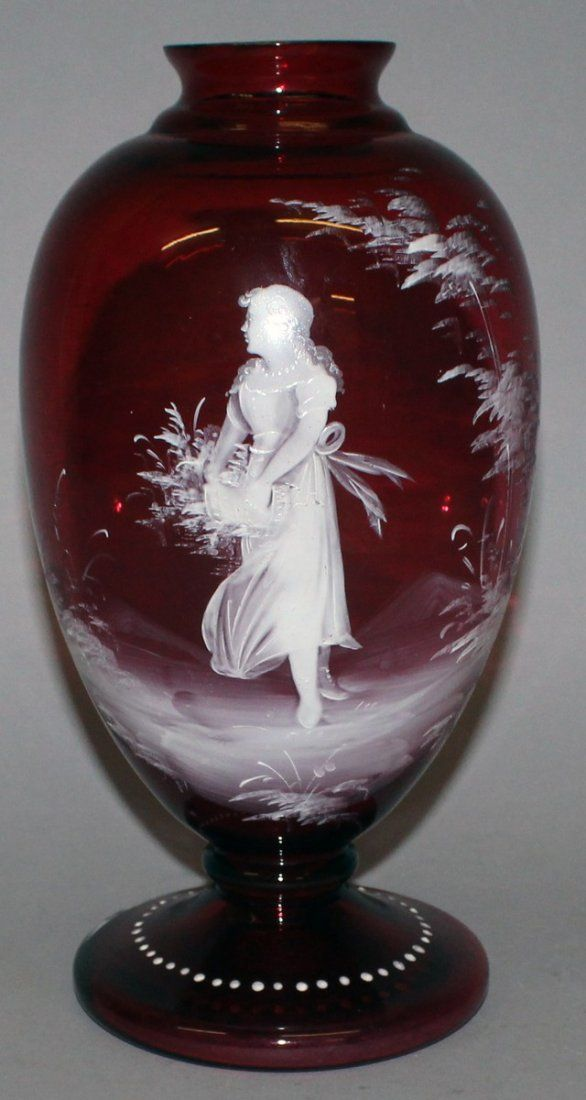 76.  A GOOD MARY GREGORY RUBY VASE enamelled with a
