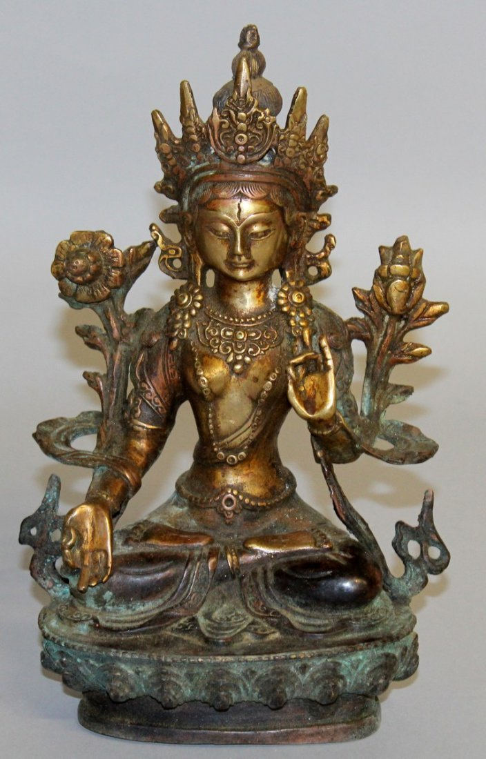 233.  A CHINESE BRONZE GOD sitting on a lotus.  9ins