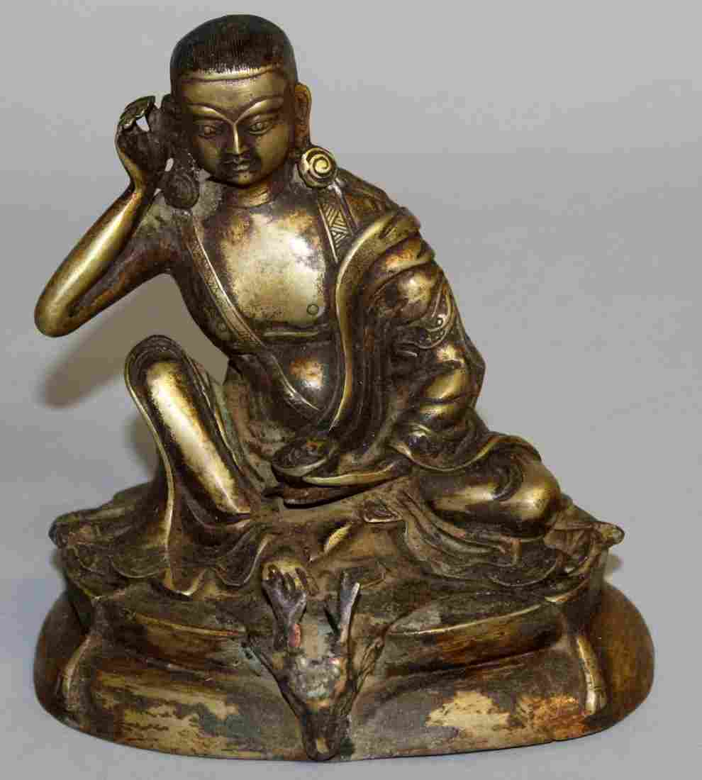 240.  A CHINESE BRONZE SEATED GOD with deer mask.  6ins