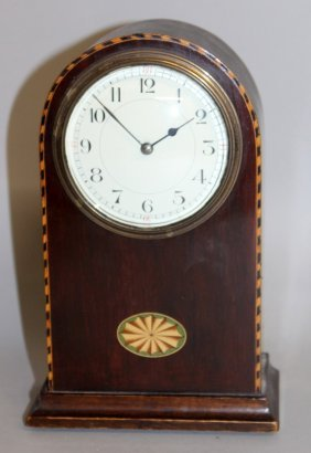 296. An Edwardian Mahogany Inlaid Mantle Clock With