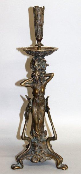 330. An Art Deco Bronze Candlestick Figure, A