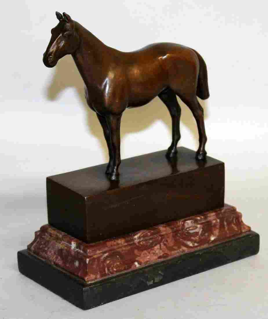 356.  A BRONZE STANDING HORSE, on a marble base.  7ins