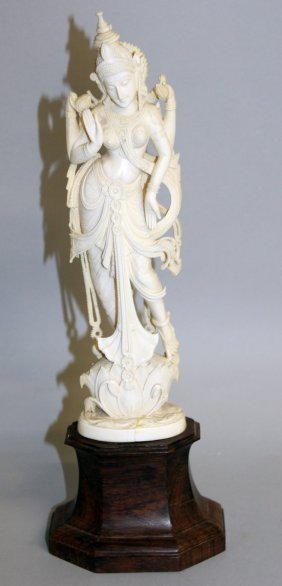 405. An Indian Carved Ivory Figure, 10ins High, On A