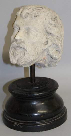 411. An Early Sandstone Carving Of A Saints Head.