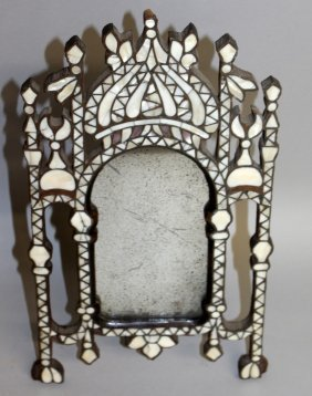 417. A 19th Century Eastern Easel Mirror Inlaid With