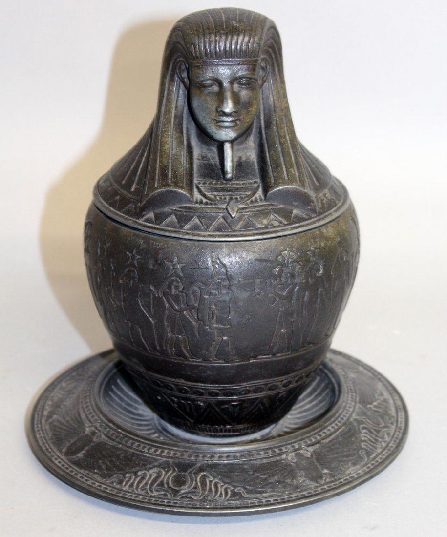 438.  A 19TH CENTURY EGYPTIAN REVIVAL BRONZE TOBACCO
