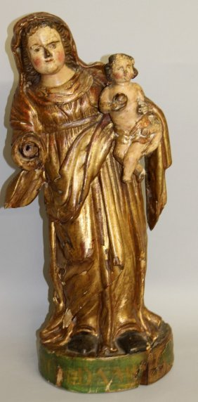 444. A 17th Century Carved And Gilded Madonna And