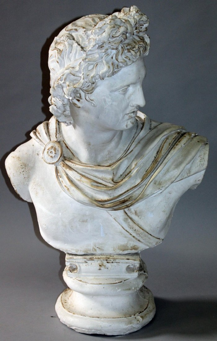 451.  AFTER THE ANTIQUE, a painted plaster bust of a