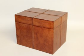 514. A Rectangular Leather Box, Each Side With Four