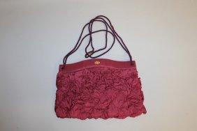 528. A Fendi Maroon Shoulder Bag.