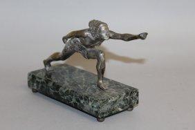 616. An Art Deco Chrome Figure Leaning Forward, On A