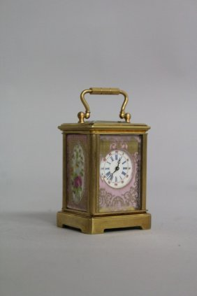 619. A Miniature Brass And Sevres Carriage Clock With