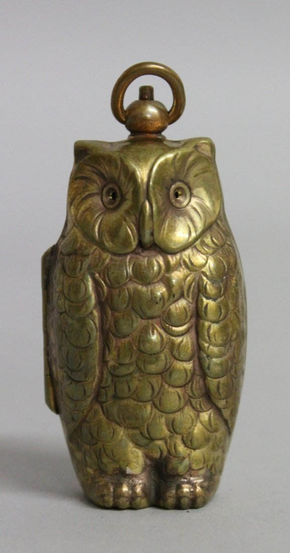 623.  A BRASS OWL SOVEREIGN AND HALF SOVEREIGN CASE.