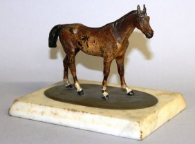 643. A Cold Cast Amusing Standing Horse On An Oval And