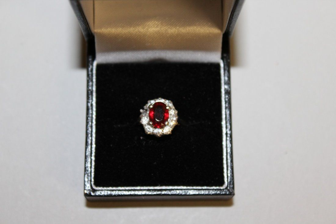 649.  A LOVELY RUBY AND DIAMOND OVAL CLUSTER RING in