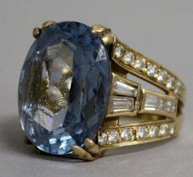 741. A Large Blue Stone Dress Ring With Diamond Set