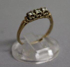 747. A Three Stone Diamond Ring In Yellow Gold,