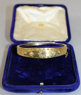762. A Victorian Yellow Gold Bangle Set With Single