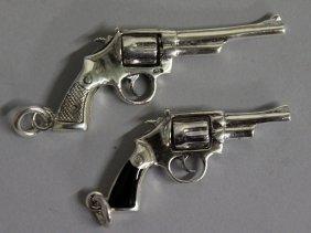 """768. Two Silver """"gun"""" Novelty Pendants."""