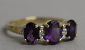 786. A 9ct Gold Amethyst And Diamond Ring.