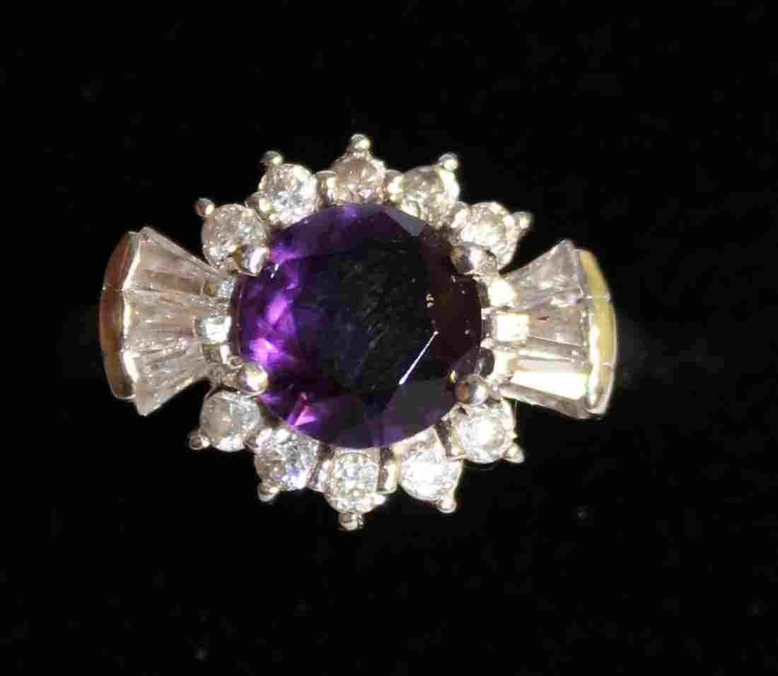 798.  A SAPPHIRE AND BRILLIANT CLUSTER RING set in