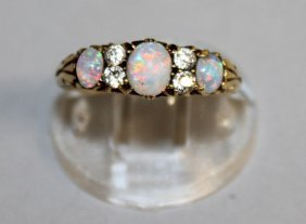 810. An Opal And Diamond Half Hoop Ring, Set In 18ct