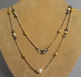 834. A Silver Gilt And Freshwater Pearl Rope Necklace.
