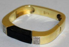 873. An 18ct Yellow Gold Onyx And Diamond Bracelet,