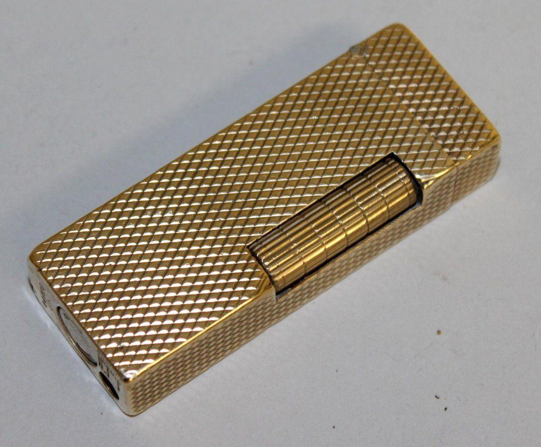 878.  A 9CT GOLD DUNHILL LIGHTER.